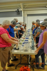 WMUMC Volunteers helping to package meals at our last SHN event.